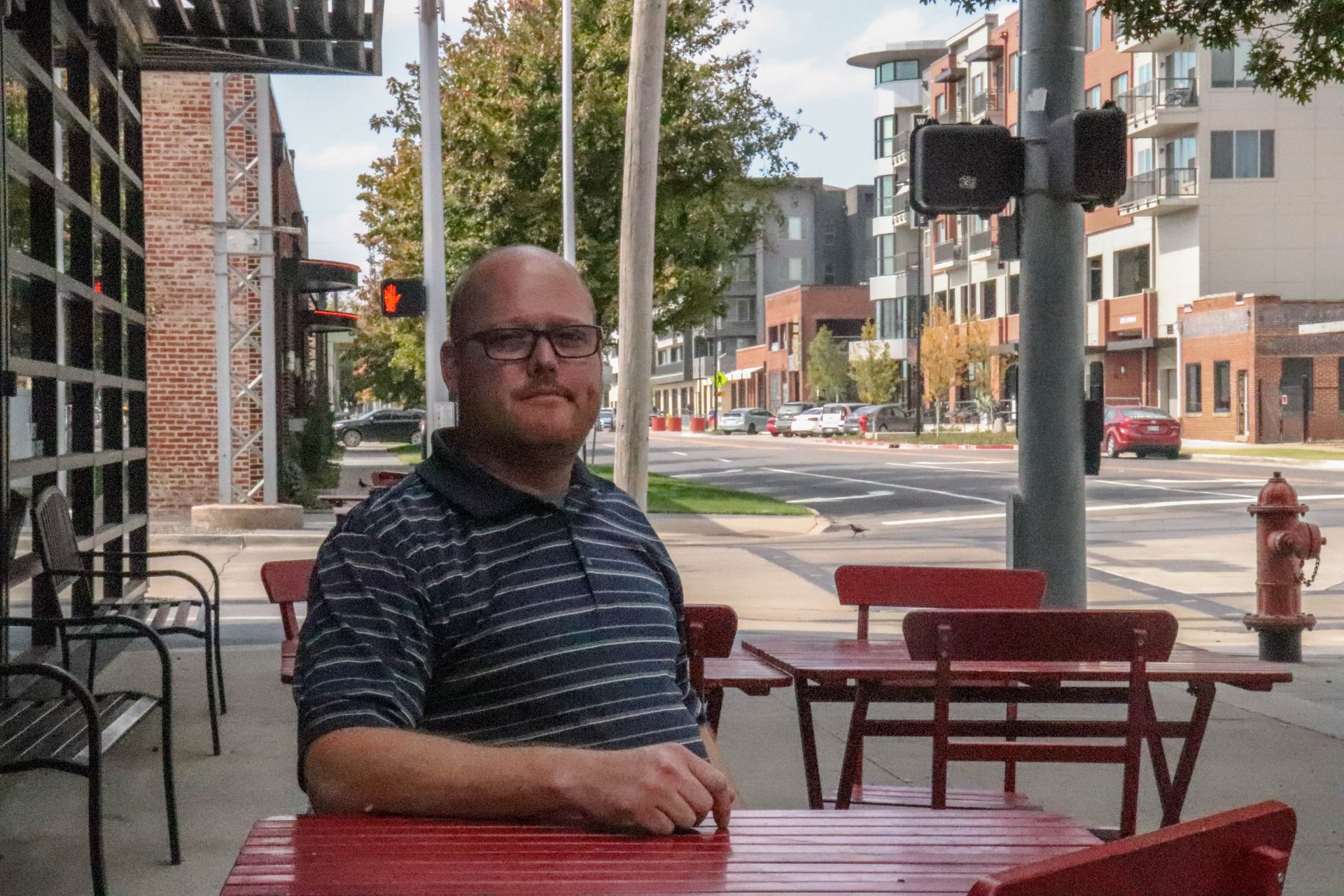 Jason Hanan sits at a red table in downtown Oklahoma City.