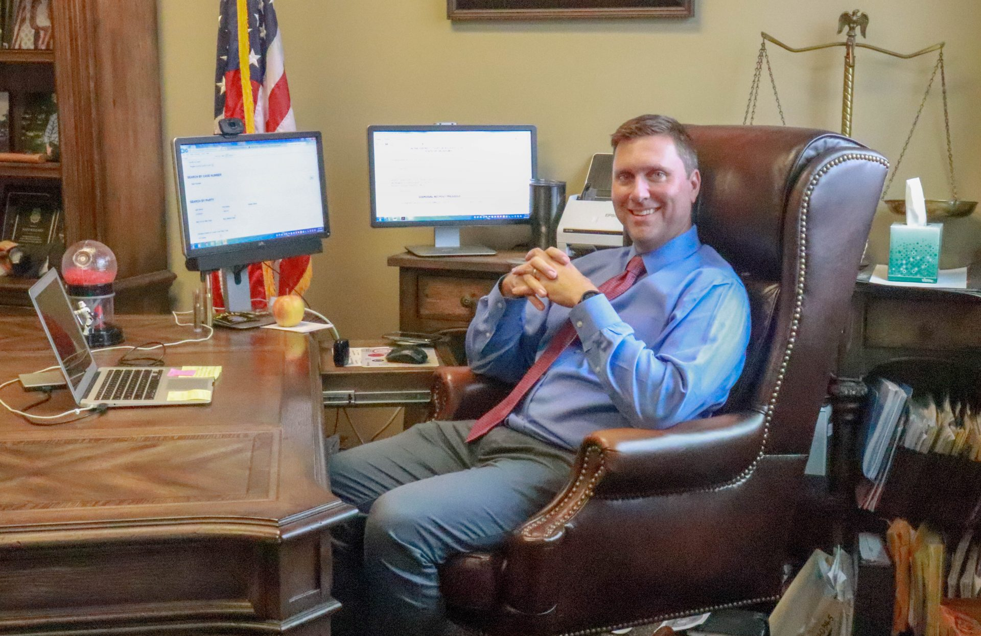 Matt Ballard sits at his desk in the Rogers County District Courthouse.