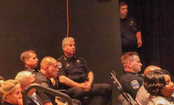 Tulsa police officers sit in the audience of a Tulsa City Council meeting.