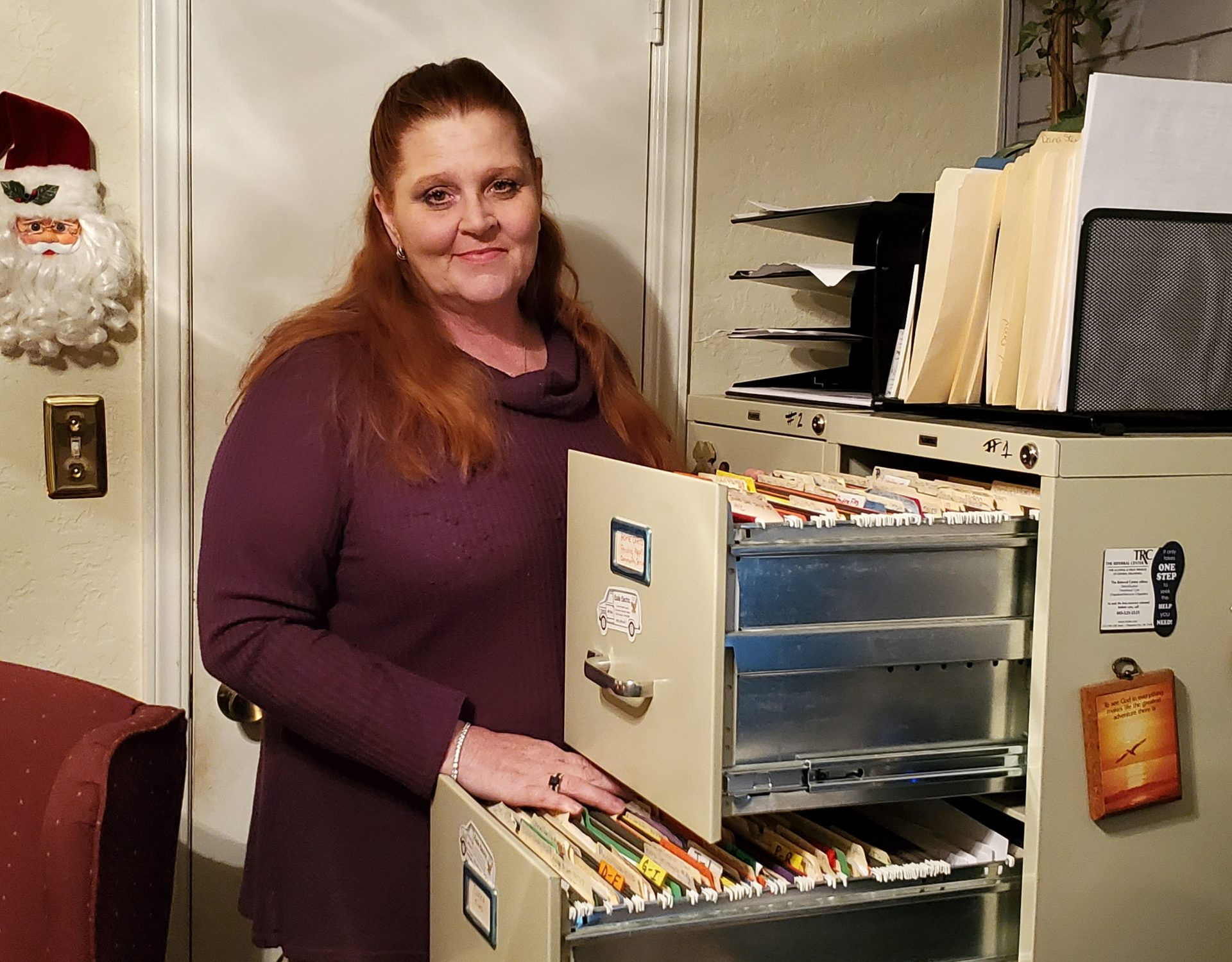 Robin Wertz stands behind her files on prisoners seeking housing at the Exodus House.
