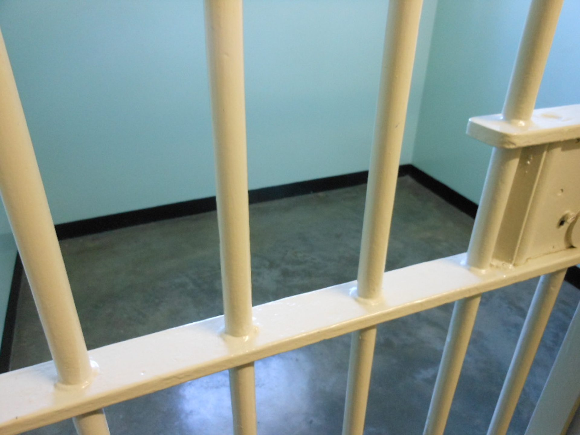 White barred jail cell