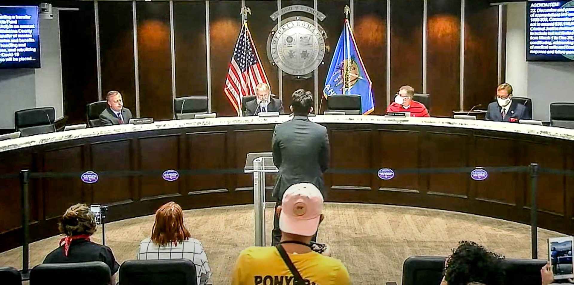 Oklahoma County commissioners conduct their August 19 meeting inside their board room.