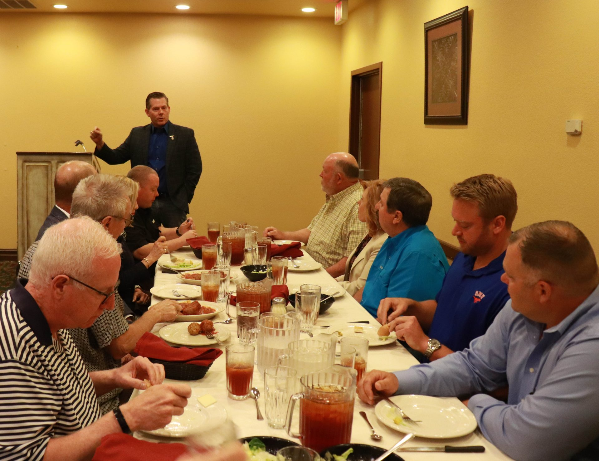 Rep. Kevin McDugle speaks to a group of legislators sitting down for lunch inside Pete's Place.