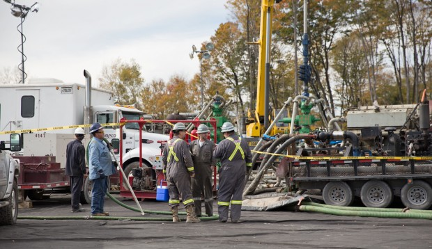 Workers vaccuum any water or fluids surrounding a frack site in Harford Township, Pa.