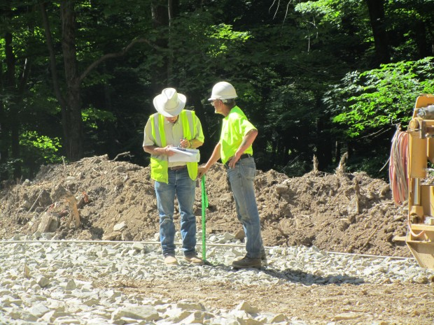 """A """"pipebender"""" from Texas oversees plans to lay a new gas pipeline in Susquehanna County. Workers prepare to lay pipe in Susquehanna County."""