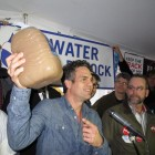 Actor Mark Ruffalo holds up a jug of water drawn from a well in Dimock, Pa. Ruffalo spoke at a rally this week after helping deliver fresh water to affected residents.