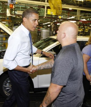 U.S. President Barack Obama (L) greets an assembly line worker while touring the Ford Motor Company Chicago Assembly Plant August 5, 2010 in Chicago, Illinois. According to reports, Ford said the plant will add 1.200 new jobs made possible by a Dept. of Energy loan that is intended to help companies retool to make fuel-efficient vehicles.