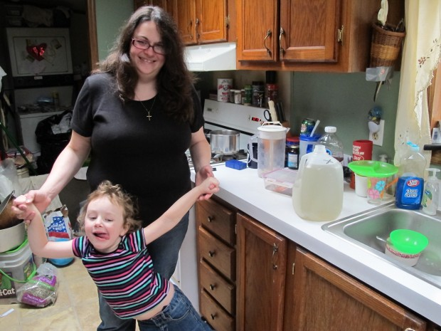 A jug of brown water from a private water well sits on Kim McEvoy's counter. McEvoy moved to a house hooked up to a public water source after she says gas drilling ruined her well water.