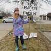 A young girl holds a sign at a rally in Butler County.