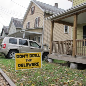 A drilling protest sign sits on the lawn of a home along the Delaware River.