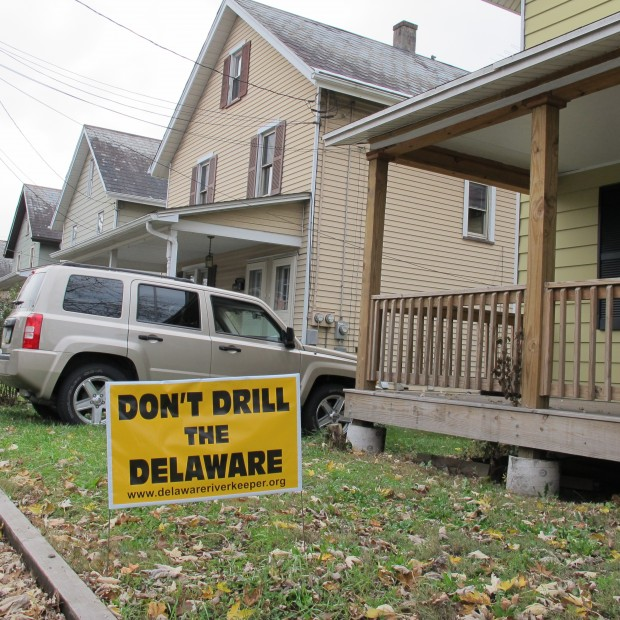 A drilling protest sign sits on the lawn of a home along the Delaware River. Opposition to drilling within the Delaware River basin is strong, and led to a stalemate among commissioners.