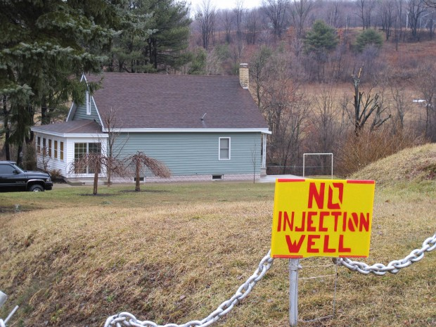 A sign protesting a proposed deep injection well sits on the lawn of a home in Brady Township, Clearfield County.
