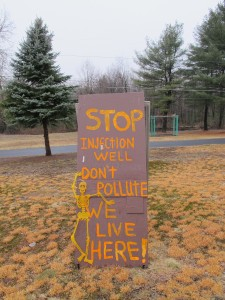 A sign opposing a planned deep injection well sits on a lawn in Brady Township, Clearfield County