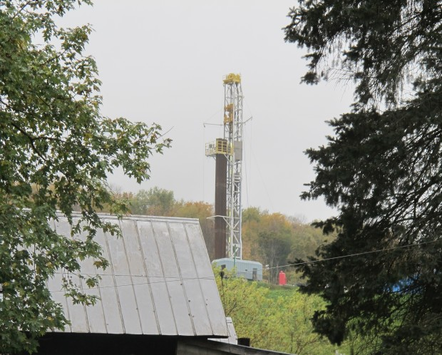 A natural gas drill rig looms above a farm in Susquehanna County, Pa.