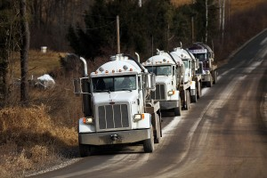 Trucks carry fluid from a natural gas drilling site in Susquehanna County