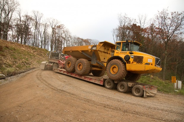 A caravan of trucks travel through the Loyalsock State Forest to a natural gas drilling site.