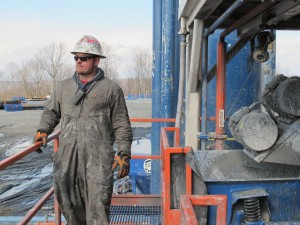 A worker stands on the platform of drill rig operated for Cabot Oil and Gas.