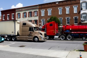 "Trucks drive down Towanda's main drag. Click on the image to view StateImpact Pennsylvania's new multimedia project, called ""Boomtown."""