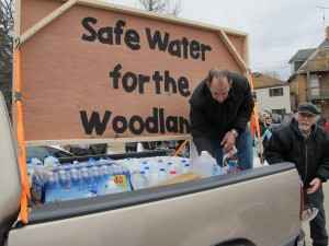 A man helps deliver donations of clean water to residents of Butler County who say gas drilling polluted their water supply, February, 2013.