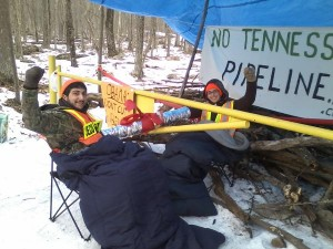 Alex Lotorto and Allison Petryk chain themselves to an access gate in the Delaware State Forest to protest construction of the Tennessee Gas pipeline in February, 2013.