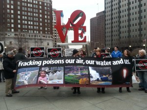 Anti-fracking activists protest gas drilling at Philadelphia's Love Park.