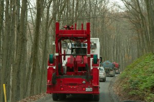 A drilling convoy heads through the Loyalsock State Forest.
