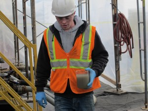 A worker collects a water sample at a natural gas wastewater recycling plant in Susquehanna County.