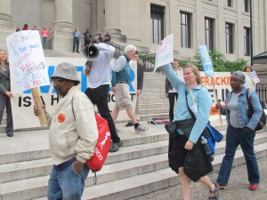 Activists marched outside the Franklin Institute protesting education cuts, welfare cuts, and natural gas drilling.