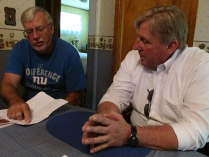 Terry Van Curen (left) shows his royalty statements to Bradford County Commissioner Doug McLinko.