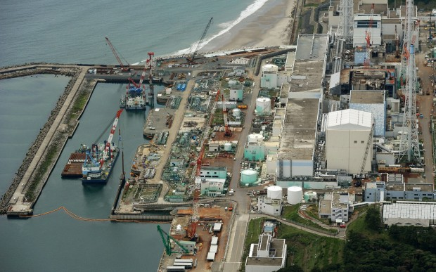 Photo taken from a Kyodo News helicopter over the town of Okuma, Fukushima Prefecture, shows the Fukushima Daiichi Nuclear Power Station on July 9, 2013. Tokyo Electric Power Co., the operator of the crippled plant, said the same day that the density of radioactive cesium in groundwater by the sea at the plant has soared to around 90 times higher than three days ago.