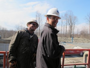 "Cabot Oil and Gas public relations officer George Stark with a drill rig worker outside of the ""dog house."""
