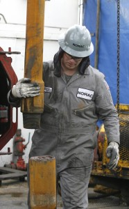A worker at a gas drilling rig near Towanda.