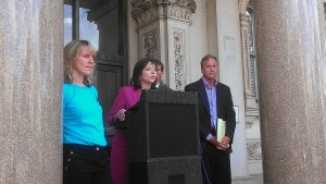 Amy Roe, center, with the Delaware Sierra Club announces the group is suing environmental regulators in Delaware and New Jersey.