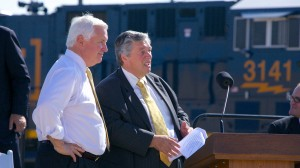 CEO of Philadelphia Energy Solutions Philip Rinaldi and Governor Tom Corbett watching a CSX train arrive supplying oil to the Philadelphia refinery.
