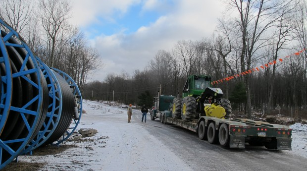 An oversize truck load moves heavy equipment through the Tiadaghton State Forest.