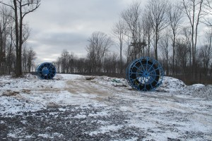 Large spools of tubing sit in an area cleared of trees in the Tiadaghton State Forest.