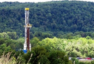 A drill rig rises above the trees in the Tioga State Forest.