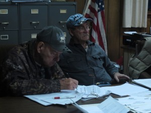 Highland Township supervisors Jim Wolfe, right, and Paul Burton, left, signed an agreement to retain legal counsel to defend the township's ban on deep injection wells.