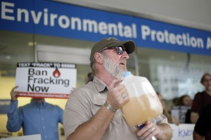 Ray Kemble of Dimock, displays a jug of what he identifies as his contaminated well water in this August 2013 file photo.