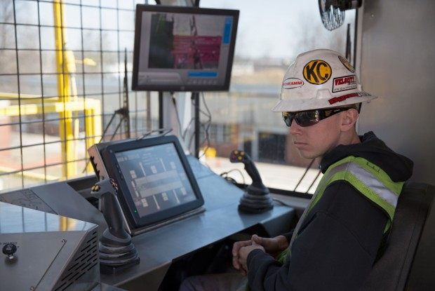 Ethan Eckard, 23, a test technician at Schramm, Inc. in West Chester, sits in the control room of the T500XD drill rig.