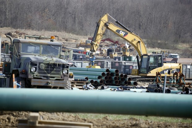 In this Thursday, April 17, 2014 photo, workers continue the construction at a gas pipeline site in Harmony, Pa. Dennis Martire, from the Laborers' International Union, or LIUNA, said that the man-hours of union work on large pipeline jobs in Pennsylvania and West Virginia have increased by more than 14 times since 2008.
