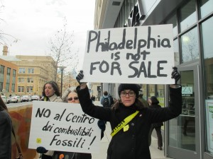 "South Philadelphia resident Maria Kretschmann joined dozens of protestors outside Drexel University's Creese Student Center where business leaders met to discuss plans for a regional ""energy hub."" Kretschmann said she is concerned about the impact of burning fossil fuels on public health and a warming planet."