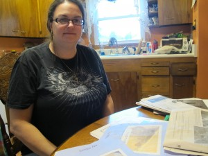 Kim McEvoy sits at the kitchen table in her new home in Butler County.