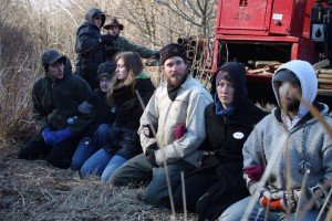 Protestors of the Atlantic Sunrise pipeline link arms before they are arrested by police for trespassing on private property in Conestoga, Pa.
