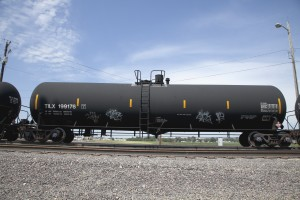A DOT-111 rail tanker travels through Council Bluffs, Iowa. The expanded use of these older freight-rail cars by the oil industry has prompted calls for safety upgrades. Philadelphia is one of busiest crude-by-rail shipment areas in the U.S.