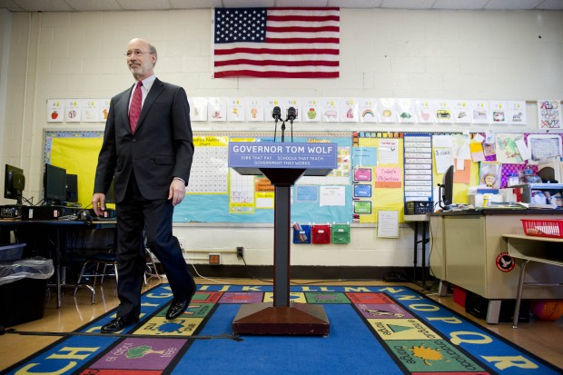"Gov. Wolf steps away from the podium at the end of a news conference at Caln Elementary School Wednesday, Feb. 11, 2015, in Thorndale, Pa.  Wolf kicked off a statewide ""Schools that Teach Tour"" and outlined a forthcoming proposal to the Legislature to increase taxes on Pennsylvania's natural gas industry to help boost aid to public schools."