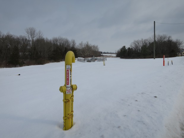 A marker shows the path of the Texas Eastern Pipeline as it a field in Lambertville, New Jersey. It is one of several natural gas pipelines buried under farms, forests, backyards and waterways in the region.
