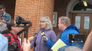 Activist Vera Scroggins speaks with reporters after an October 2014 court hearing.