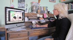 Anti-fracking activist Wendy Lee sorting through photos she's taken at gas sites.