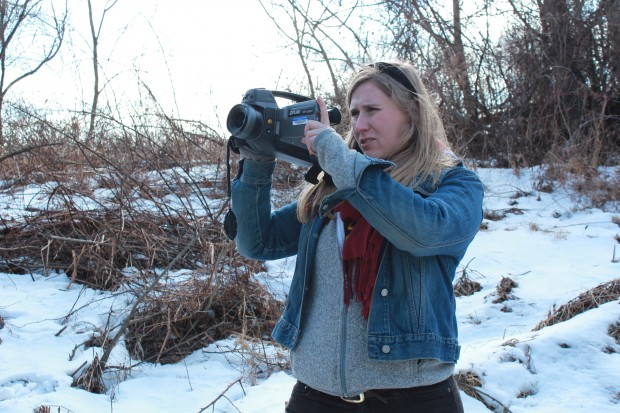 Researcher Melissa Sullivan uses an infrared FLIR camera to determine if methane is leaking from a well site.